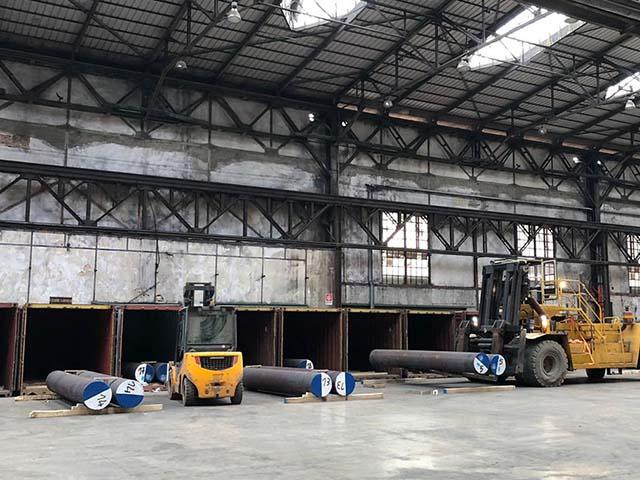 pastrello-trasporti-logistica-siderurgico-deposito-interno-svuotamento-container-tondoni
